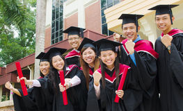 Asian university graduates. Group of excited university graduates Stock Photography