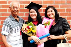 Asian graduation. Asian university student and family celebrating graduation outdoor royalty free stock photography