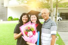 Asian graduation. Asian university student and family celebrating graduation outdoor royalty free stock image