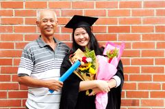 Asian graduation. Asian university student and father celebrating graduation stock photos