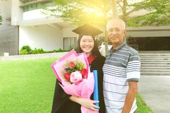 Asian graduation. Asian university student and father celebrating graduation outdoor royalty free stock photography