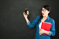 Asian university student scared to be late for class Royalty Free Stock Images