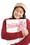 Asian valentine girl. A happy beautiful asian girl holding a valentine gift Stock Photography