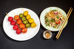 Asian variegated meatball, vegetable salad and chopstick Royalty Free Stock Image