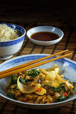 Asian vegetable dish with chopsticks on a bamboo mat, rice and s Royalty Free Stock Photo