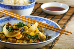 Asian vegetable dish with chopsticks on a bamboo mat and a rusti Royalty Free Stock Photos