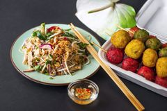 Asian vegetable salad and colorful meatball Royalty Free Stock Image