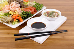 Asian food soy sauce chopsticks. Selection of asian vegetables with peeled prawns, soy sauce, chilli dip and chopsticks royalty free stock photo
