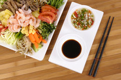 Asian food soy sauce chopsticks. Selection of asian vegetables with peeled prawns, soy sauce, chilli dip and chopsticks stock images