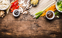 Asian Vegetarian Cooking Ingredients For Stir Fry With Tofu, Noodles, Ginger, Cut Vegetables, Sprout,green Onion , Lemongrass, Hoi Stock Photo