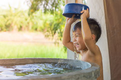 Free Asian Village Poor Boy Is Taking A Bath From Village Water Well. Royalty Free Stock Image - 79806756