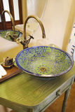 Asian vintage washbasin and chrome tap Stock Image