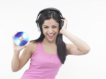 Asian virgin with her compact disc Stock Photos