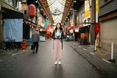 Asian visitor standing in the street. royalty free stock photo
