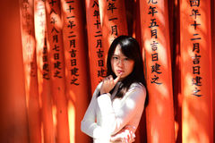 Asian visitor taking photo at Red Torii gates Royalty Free Stock Photo