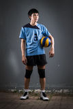 Asian volleyball athlete in action Royalty Free Stock Image