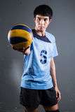 Asian volleyball athlete in action Stock Images