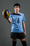 Asian volleyball athlete in action Stock Photography