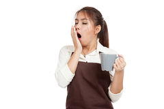 Asian waitress  in apron yawn with cup of coffee Royalty Free Stock Image