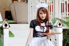 Asian waitress with wine glass concept Royalty Free Stock Images