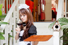 Asian waitress with wine glass concept Royalty Free Stock Photo