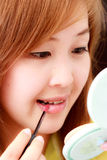 Asian waman making up her face Stock Photos