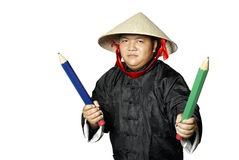 Asian warrior with large pencils Stock Photography