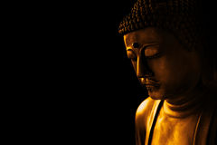 Asian way tranquil of meditation and religious. Closeup face of zen stone art buddha in dark for background asian way tranquil of meditation and religious Royalty Free Stock Photography