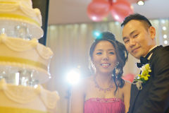 Asian wedding cake cutting Royalty Free Stock Image