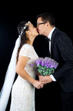 Asian wedding couple. Attractive Bride and Groom at Wedding over black background Stock Photography