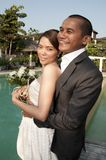 Asian wedding couple in tropical location Royalty Free Stock Photo