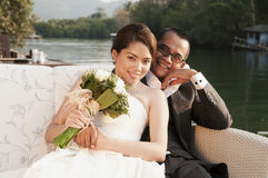 Asian wedding couple in tropical location Royalty Free Stock Photography