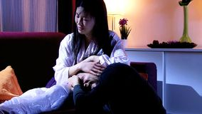 Asian wife caressing crying husband after fight stock footage