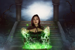 The asian witch with cauldron practice witchcraft. In the forest Royalty Free Stock Photos