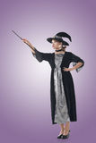 Asian witch hold something Royalty Free Stock Photography