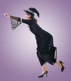 Asian witch riding something Stock Photography