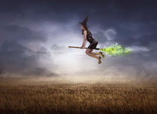 Asian witch using broom flying Royalty Free Stock Photography