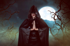 Asian witch woman casting spell in the night Stock Photography