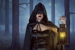 Asian witch woman holding lantern Royalty Free Stock Photos