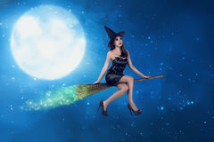 Asian witch woman ride the broom on the sky. In the night with moonlight background royalty free stock photography