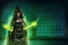 Asian witch woman wearing black costume in empty room. Her hand Royalty Free Stock Image