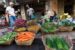 Asian wman selling vegetables Royalty Free Stock Photo