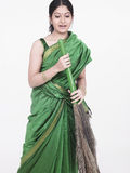 Asian woam with a broom Stock Images
