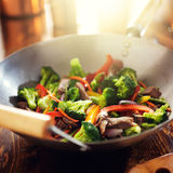 Asian wok with beef and vegetable stir fry. Shot with selective focus and lens flare Stock Photo