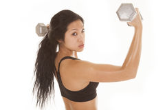 Asian woma fitness side weights up Stock Image