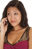 Asian woma phone small smile Royalty Free Stock Photos