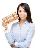 Asian woman and abacus Stock Image