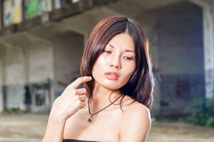 Asian woman at abandoned building Royalty Free Stock Photos