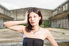 Asian woman at abandoned building Stock Photo