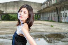 Asian woman at abandoned building Stock Images